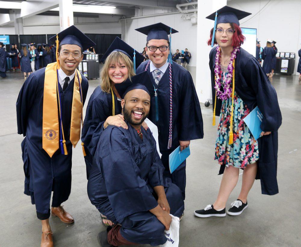 Graduates posing in fun zone area.