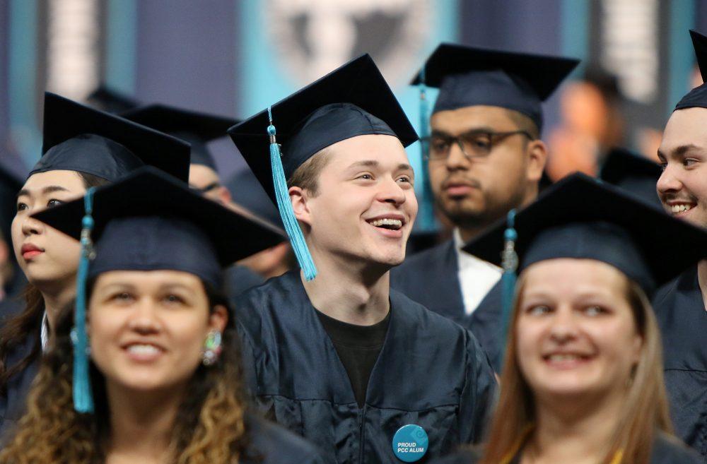 Happy grad in coliseum.