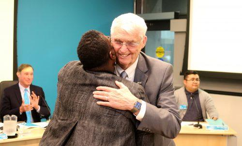 Harper hugs Justice Nelson.
