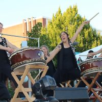 Taiko drummers on stage