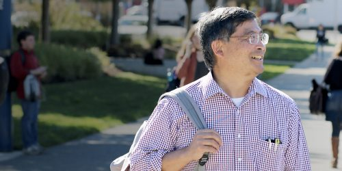 Mark Mitsui with backpack at Southeast Campus