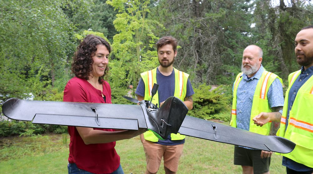 Christina Friedle with her students and the drones.