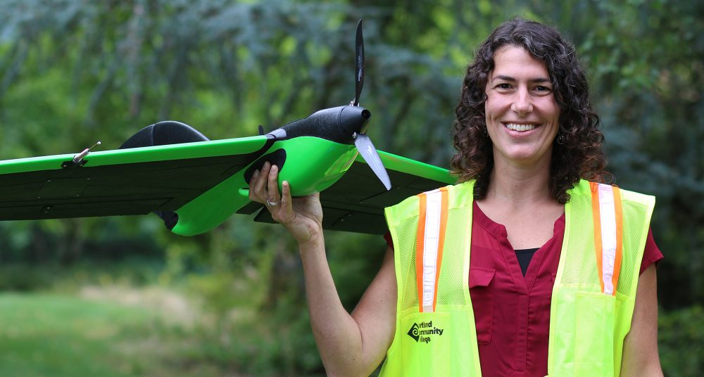 Christina Friedle with fixed wing drone.