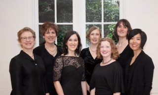 six women in black dresses