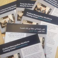 Metro Center canvassing leaflets in several languages.