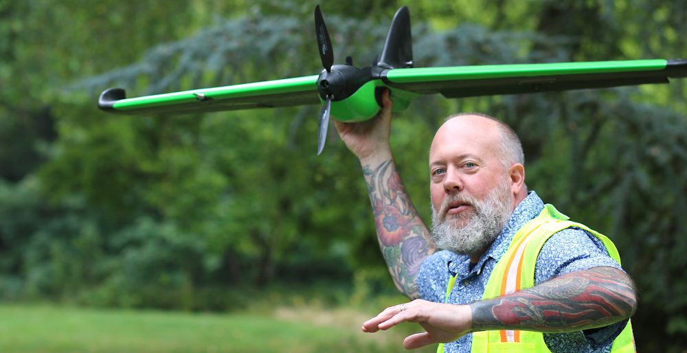 Mike Holscher with fixed-wing drone.