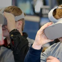 Two students enjoy their virtual training goggles