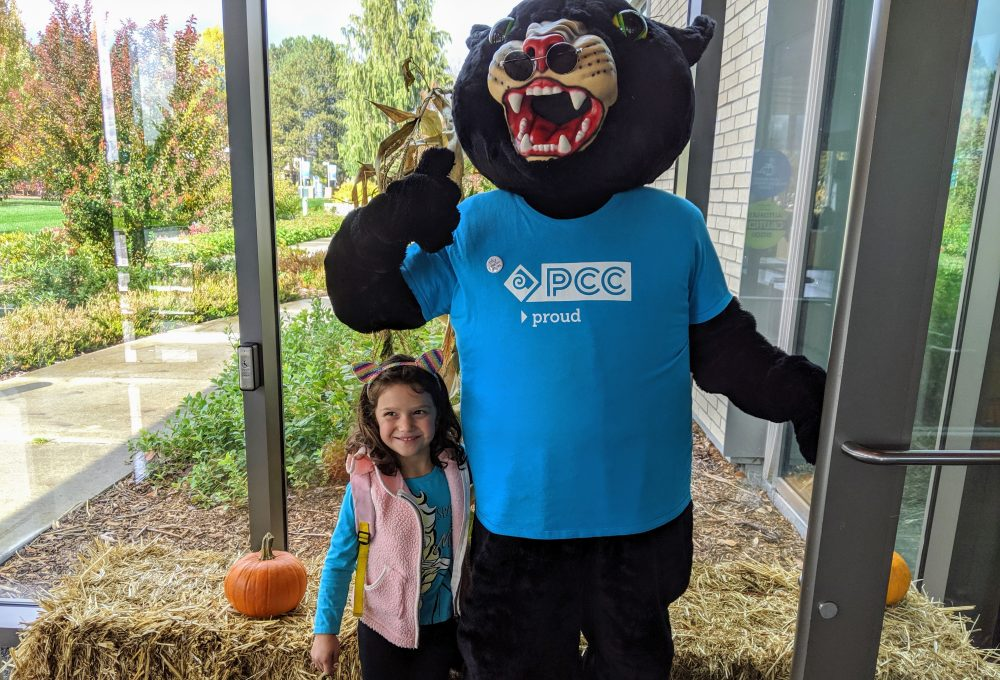 little girl with Poppie the Panther mascot