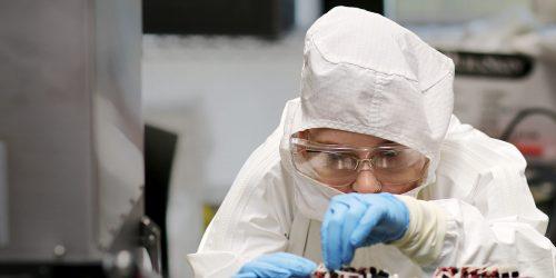 Sarah Teters operates microelecronics machine