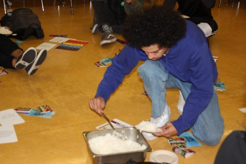 Picture of student serving themselves rice