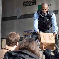 Lamar Hurd unloads first boxes of food