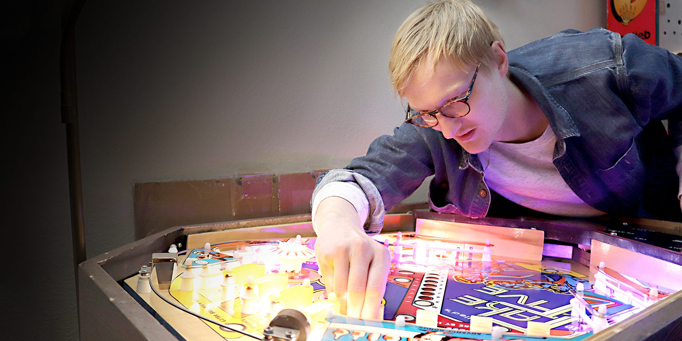 Luke Christensen working on a pinball machine