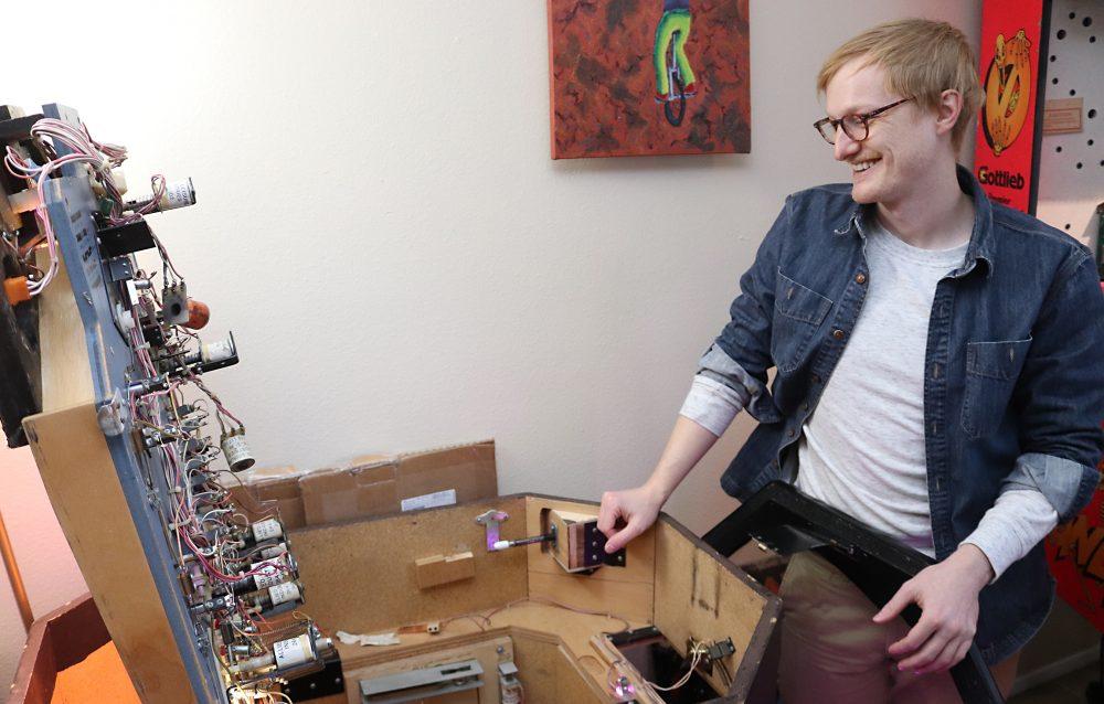 Luke repairs a machine