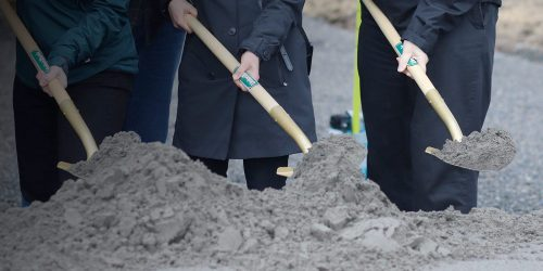 Groundbreakers digging with shovels