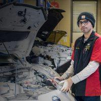 Salomon working on a car
