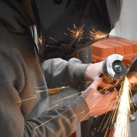Student welding in shop