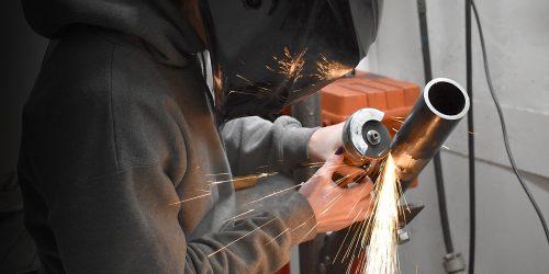 Student welding in shop