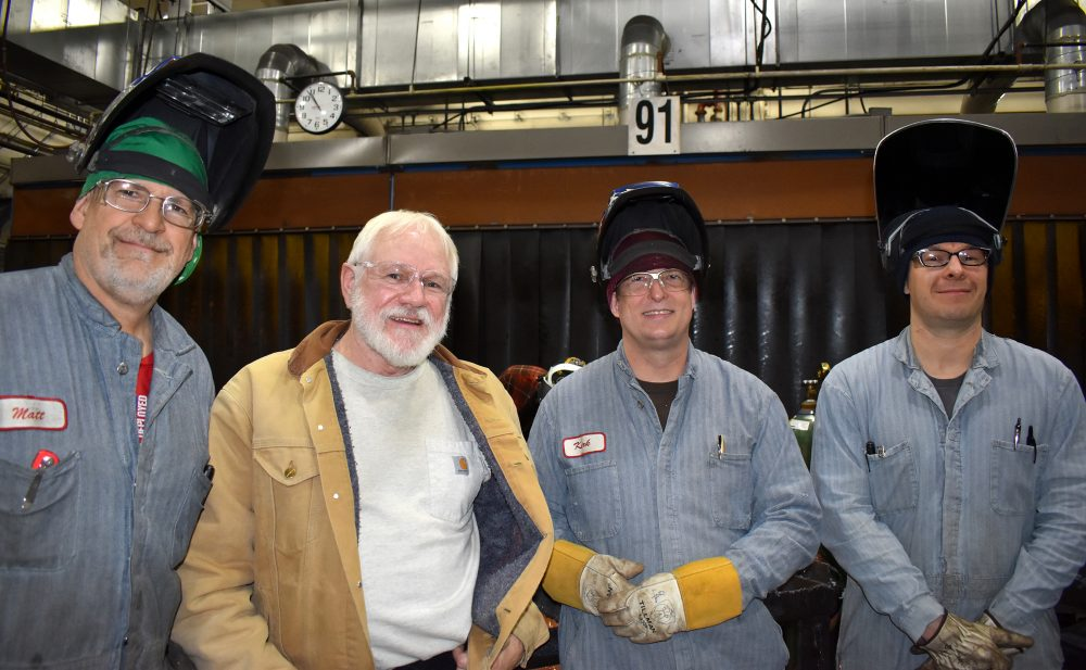 Welding faculty (left to right) Matt Scott, Scott Judy and Kirk Ebberts take a moment to pose with staffer Aaron Gardner.