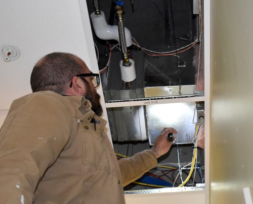 Jimmy Hood checks HVAC duct.