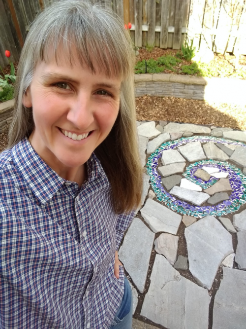 Dr. Lowgren shows off her backyard patio project.