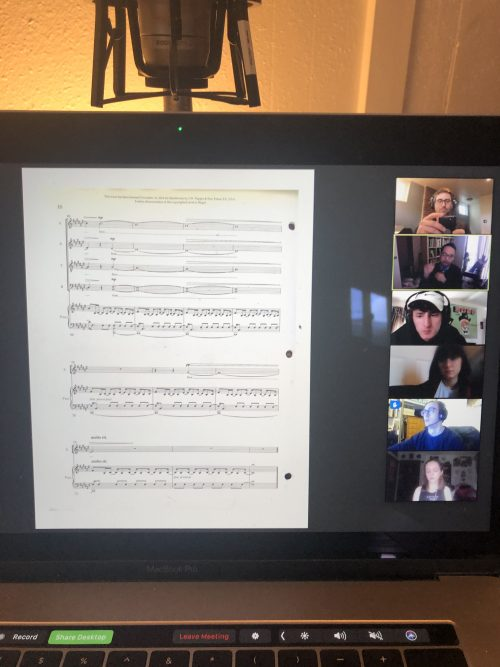 screenshot of sheet music and students in a video meeting