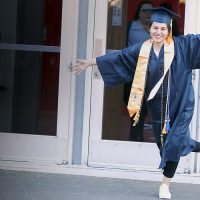 Woman celebrates at commencement.
