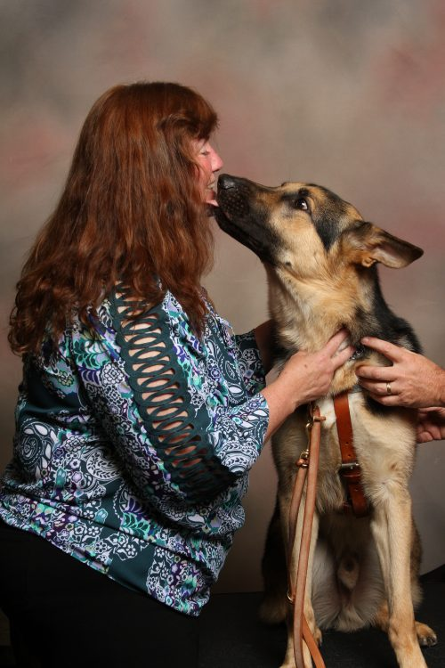 Pat Kepler with Gus the service dog.