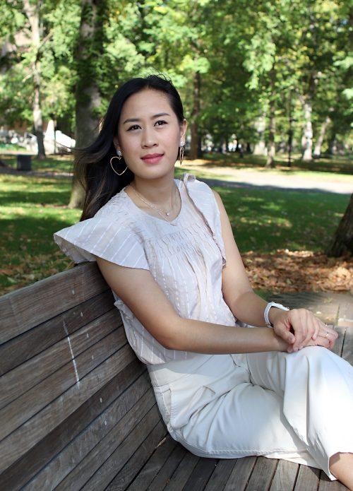 Tunyanit Khuankhruea sits on a park bench