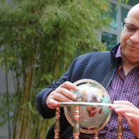 Ali looking at a globe