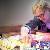 """Luke Christensen, """"Pinball Wizard"""", repairing a pinball machine"""