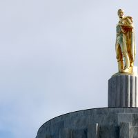 Gold pioneer on capitol dome.