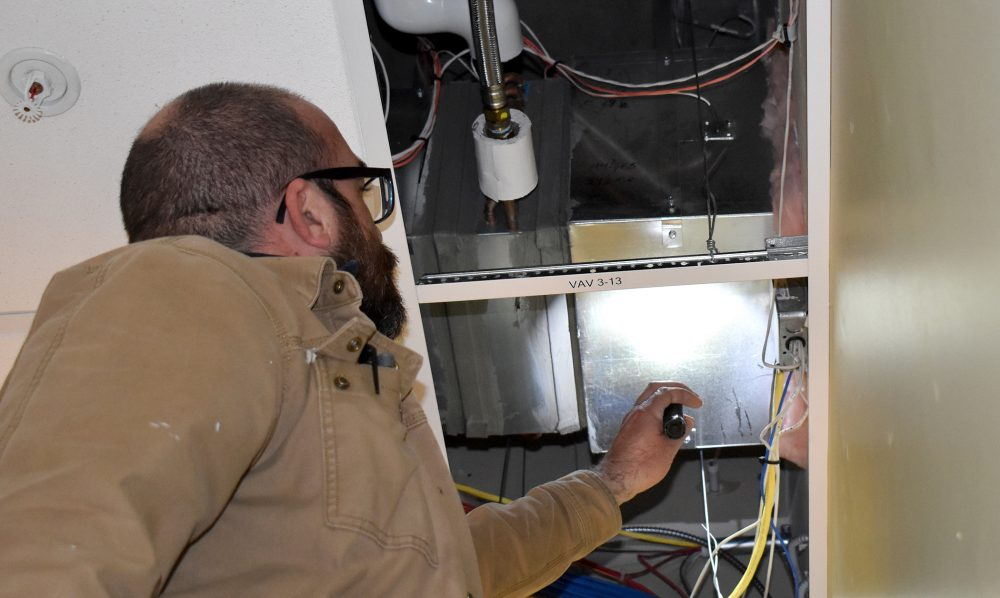 Jimmy Hood inspects HVAC systems.
