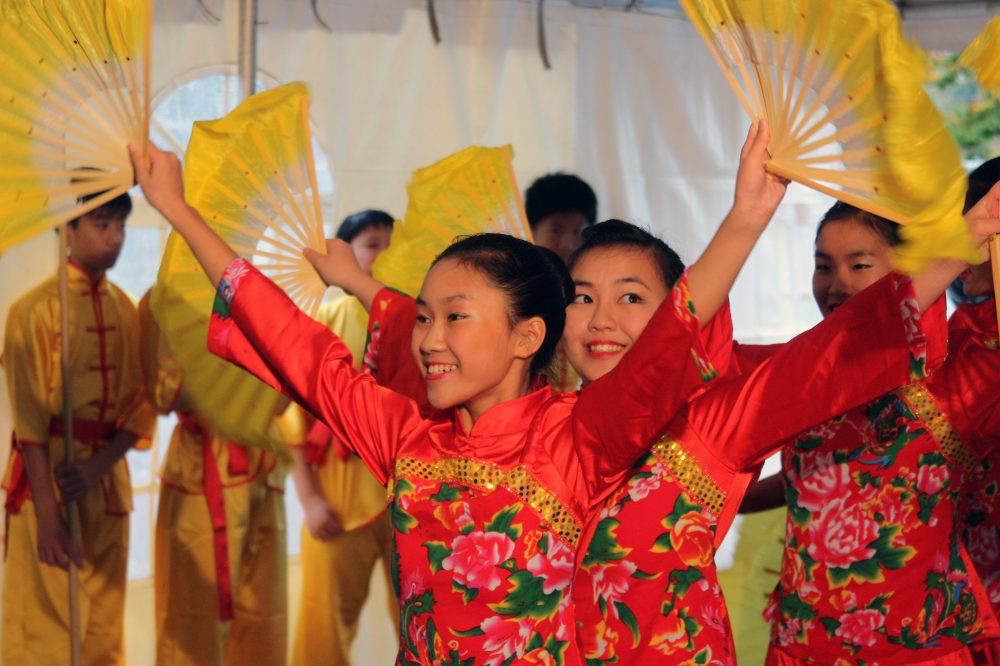 Young Chinese martial arts and dance performers from the Portland Art & Cultural Center entertain the large crowd at PCC's Southeast Campus groundbreaking in 2012.
