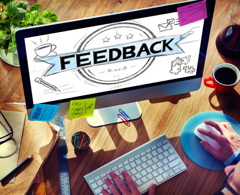 A computer screen with the word feedback on it