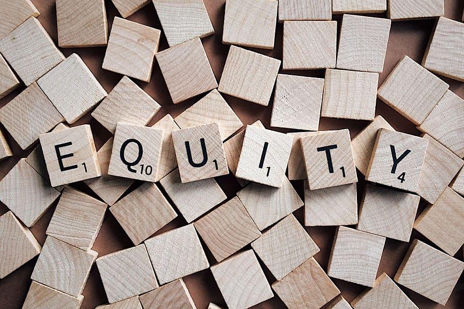 "scrabble tiles spell the word ""equity"""