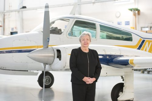 Pat Reese in front of an airplane