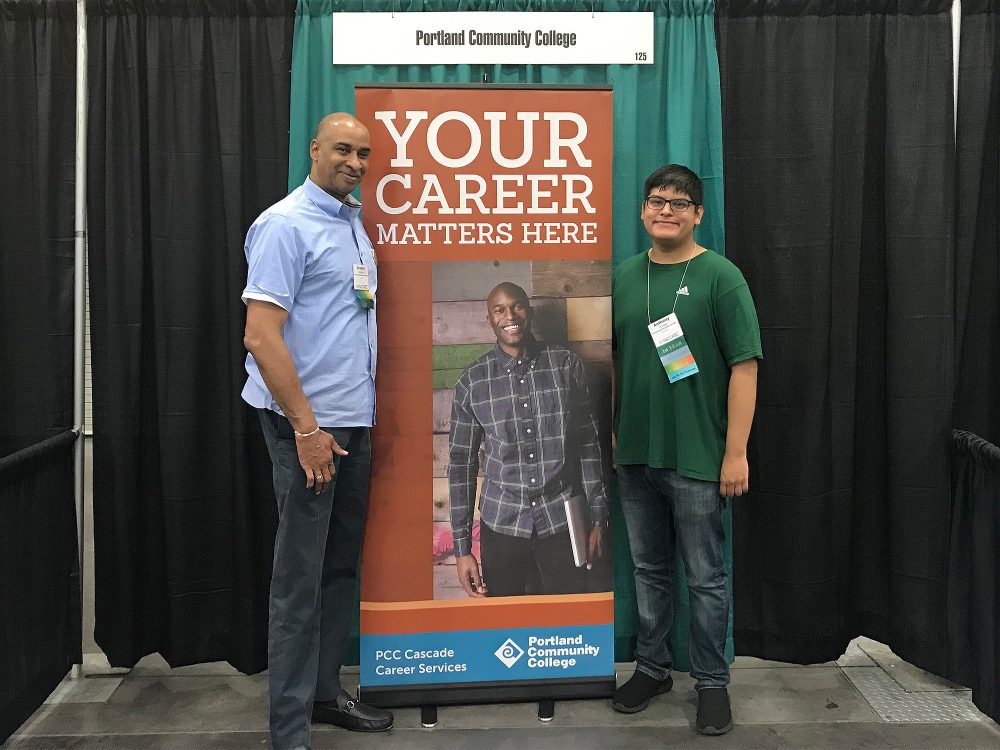 Anthony in front of a sign that says Your Career Matters Here