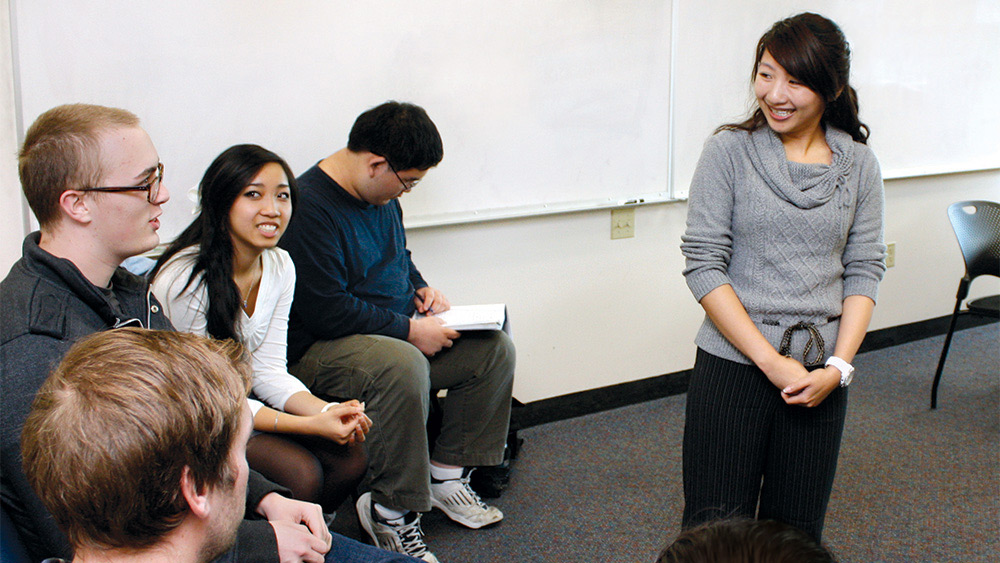Students sitting in a circle and talking