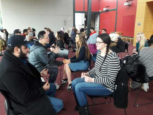 Students participate in cultural exchange conversations