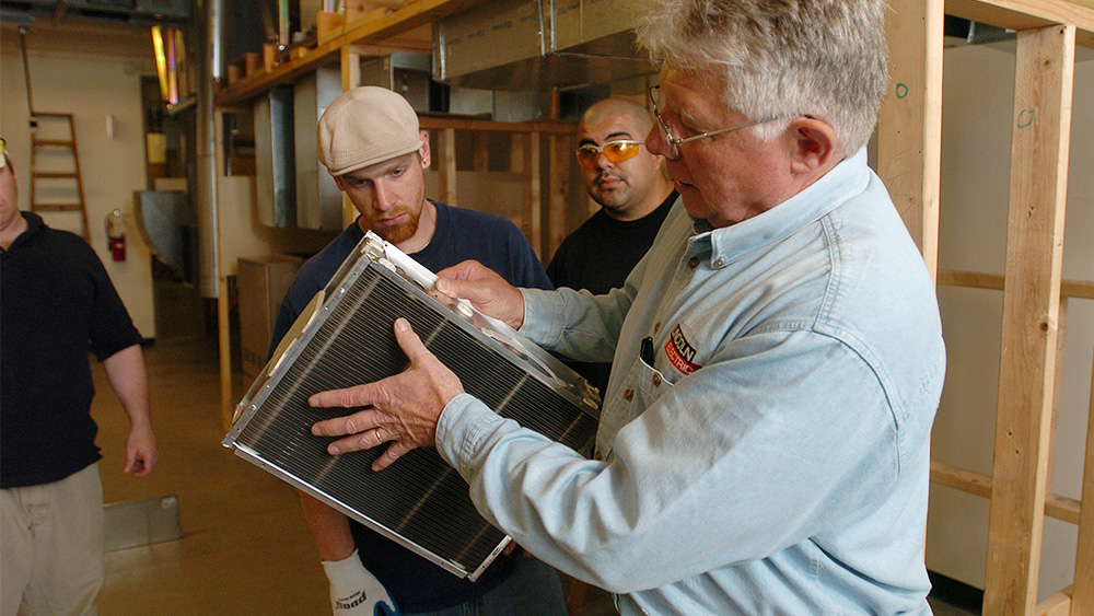 Students looking at materials in the classroom with an instructor