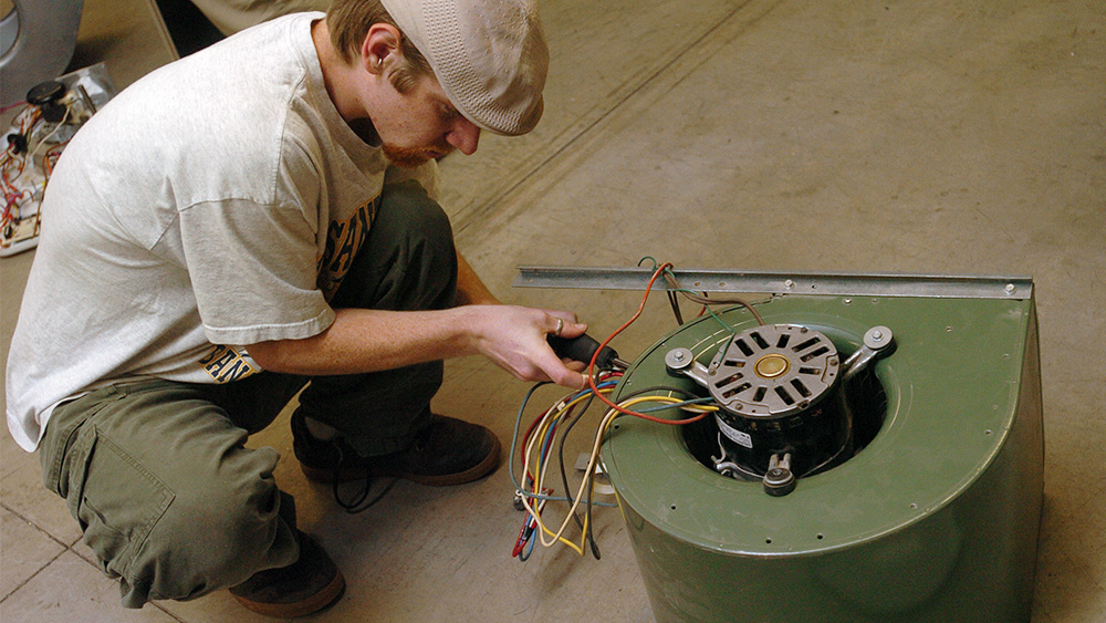 Student working with a piece of machinery