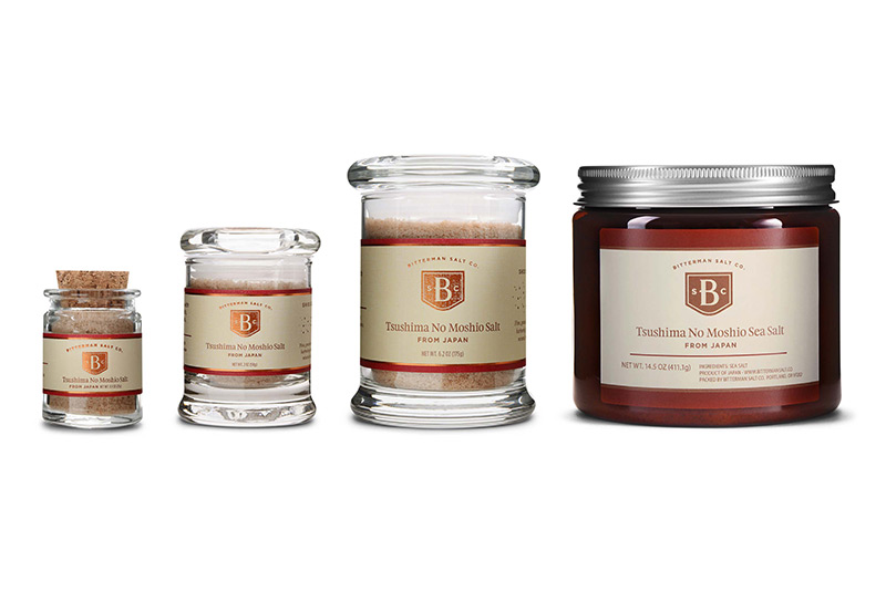 Photograph of 4 decorative salt jars on a white background