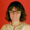 Rachel Siegel in front of a red wall