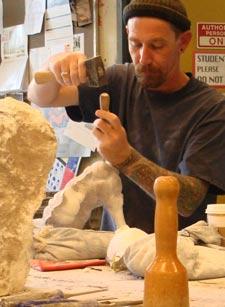 Student working in the sculpture studio