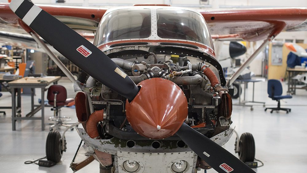 Front of an airplane with the propeller and engine showing