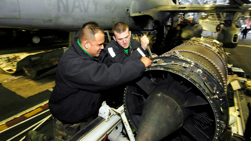 Students working on a jet engine