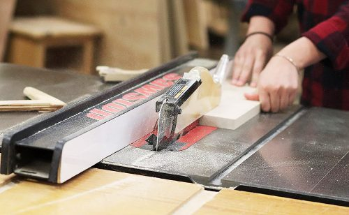 Student using a table saw