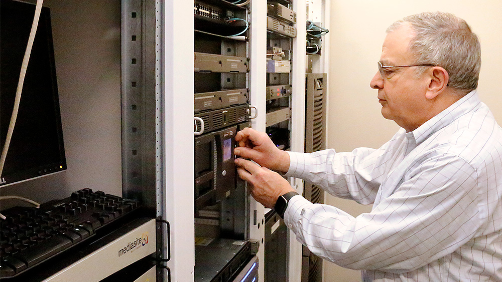 Instructor working with a server bank