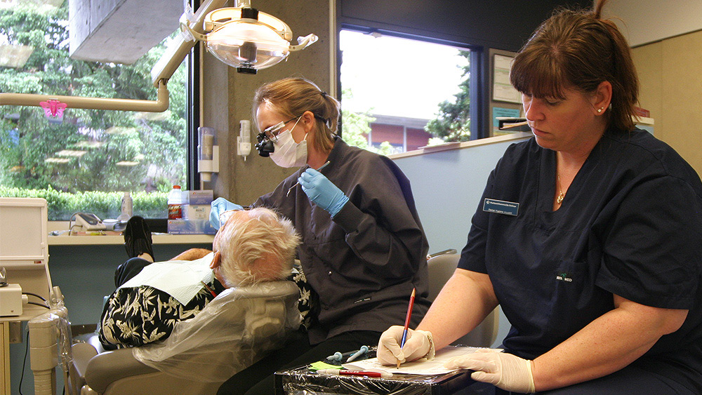 Dental Assisting student working with a patient in the clinic