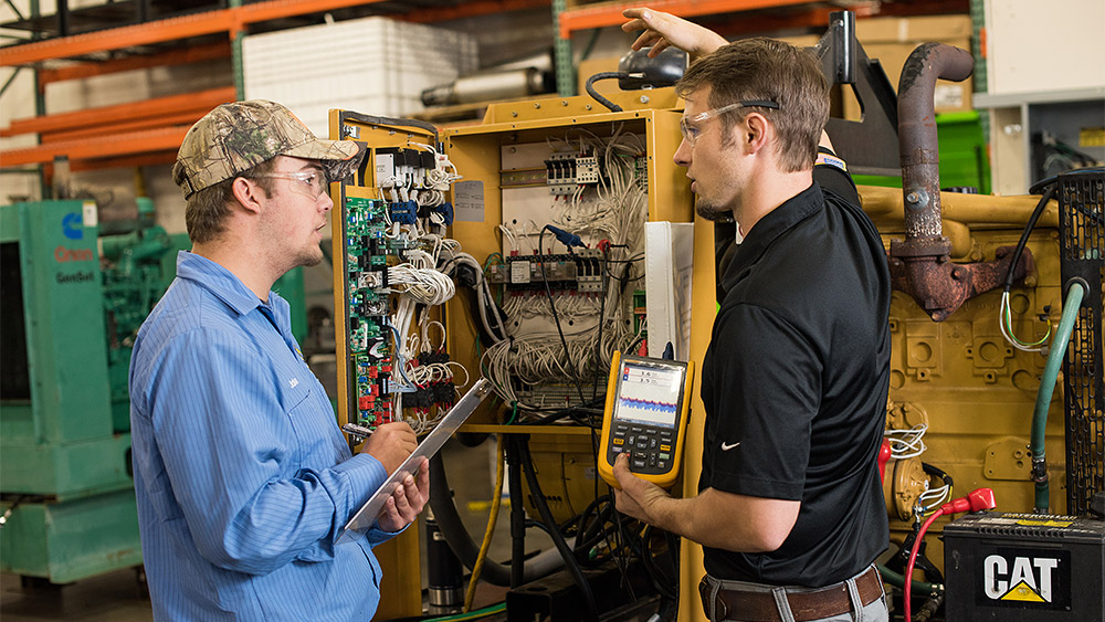 Student and instructor working with an electrical panel